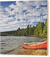 Red Canoe On Lake Shore Wood Print