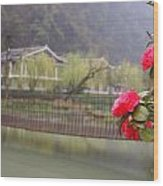 Red Flower Over Bridge Wood Print