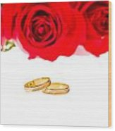 Red Roses And Wedding Rings Over White Wood Print
