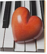 Red Stone Heart On Piano Keys Wood Print