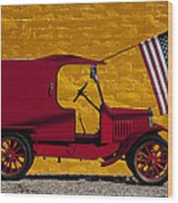 Red Truck Against Yellow Wall Wood Print
