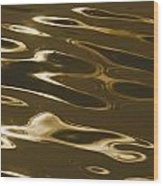 Ripples Of Water Reflect The Setting Wood Print