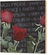 Roses Glow Against The Black Granite Wood Print