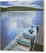 Rowboat Docked On Lake Wood Print