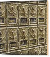 Rows Of Post Office Mailboxes With Combination Locks And Brass O Wood Print