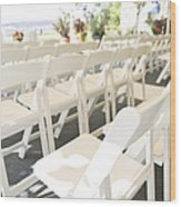 Rows Of White Folding Chairs Wood Print by Ned Frisk
