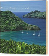 Sailboats Anchored In A Cove Of Blue Wood Print by Tim Laman