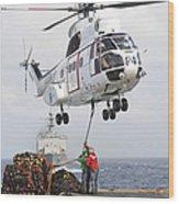 Sailors Hook Up A Pole Pendant Wood Print by Stocktrek Images