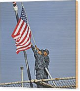Sailors Lower The National Ensign Wood Print