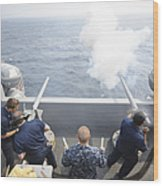Sailors Perform A 21-gun Salute Aboard Wood Print by Stocktrek Images