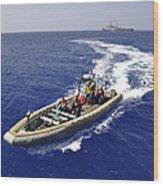 Sailors Transit An Inflatable Boat Wood Print