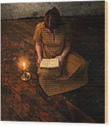 Schoolgirl Sitting On Wood Floor Reading By Candlelight Wood Print