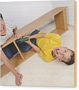 Screaming Mother And Son Assembling Furniture Wood Print