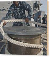 Seaman Runs A Mooring Line Wood Print