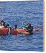 Search And Rescue Swimmers Retrieve Wood Print