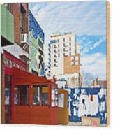 Shops On A City Street Wood Print by Eddy Joaquim