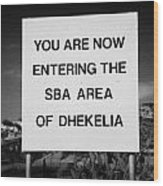 sign marking entrance of SBA Sovereign Base area of Dhekelia in the british controlled cyprus Wood Print by Joe Fox