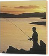 Silhouette Of A Fisherman Fishing On Wood Print