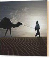 Silhouette Of Berber Leading Camel Wood Print