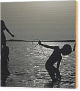 Silhouette Of Boys Fishing Wood Print