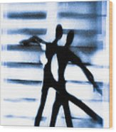Silhouette Of Dancers Wood Print by David Ridley