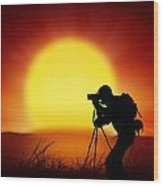 Silhouette Of Photographer With Big Sun  Wood Print