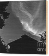 Silhouetted House And Clouds Wood Print