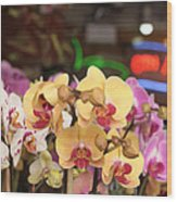 Sixth Avenue Orchids Wood Print by Denice Breaux