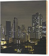 Skyline Of Singapore At Night As Seen From An Apartment Complex Wood Print