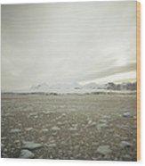 Slush Fills The Sea Under A Cloudy Sky Wood Print