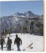 Soldiers Board A U.s. Army Uh-60 Black Wood Print