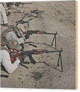 Soldiers Fire A Russian Rpk Kalashnikov Wood Print