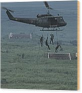 Soldiers Rappel From A Helicopter Wood Print