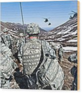 Soldiers Wait For Uh-60 Black Hawk Wood Print