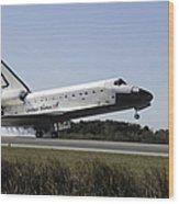 Space Shuttle Atlantis Touches Wood Print