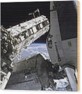 Space Shuttle Discovery Docked Wood Print