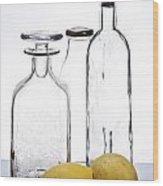 Still Life Of Bottles  And Lemons Wood Print