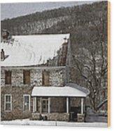 Stone Farmhouse In Snow Wood Print by John Stephens