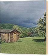 Storm Clouds Form Above A Log Cabin Wood Print