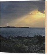 storm light - A morning light iluminates lighthouse through clouds in an amazing landscape Wood Print