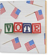 Studio Shot Of Small American Flags And Wooden Blocks With Text Vote Wood Print