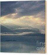 Sunlight And Clouds Over An Alpine Lake Wood Print