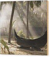 Sunlight Shining On A Canoe Wood Print