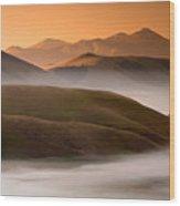 Sunrise Castelluccio Di Norcia In Morning Fog Wood Print
