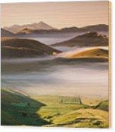Sunrise In Castelluccio Di Norcia In Morning Fog Wood Print