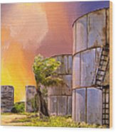Sunset And Abandoned Oil Tanks Wood Print