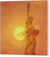 Sunset Behind The Statue Of Liberty Wood Print
