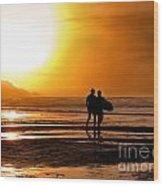 Sunset Surfers Wood Print by Richard Thomas