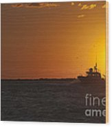 Sunset With Fishing Boat At Sea Wood Print