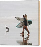 Surfers And A Pelican Wood Print